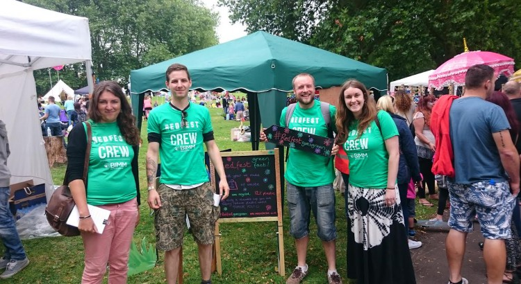 The Redfest sustainability team (two men, two women, wearing green Redfest crew t shirts)